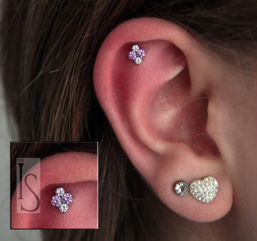 Helix piercing body piercing by martin radziunwe